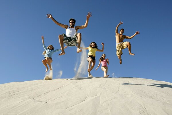 Jump friends with a sand pile