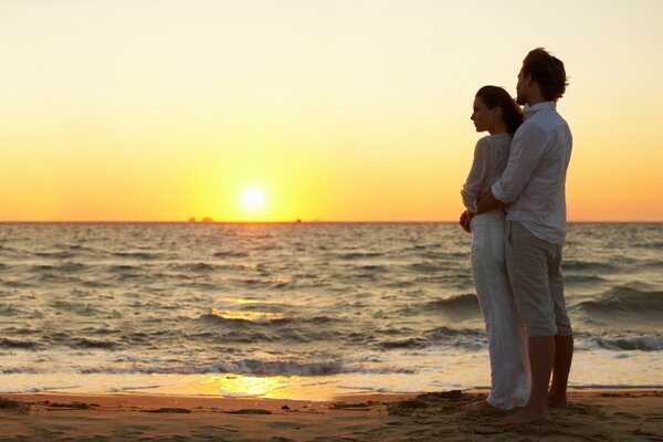 Loving couple admiring the sunset