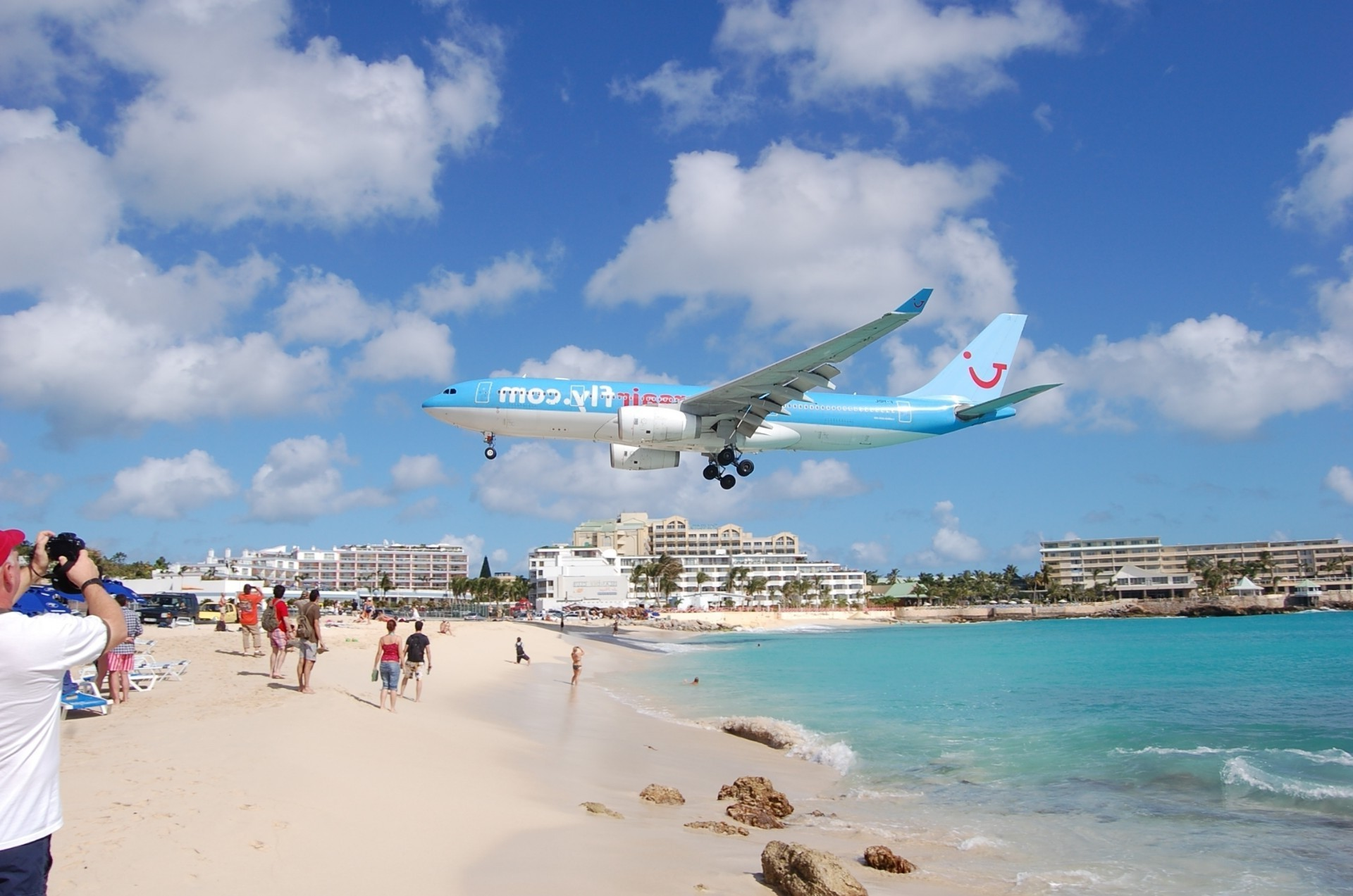 Emergency landing of plane on a crowded beach