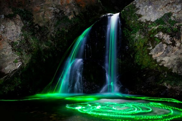 Waterfall with light green over