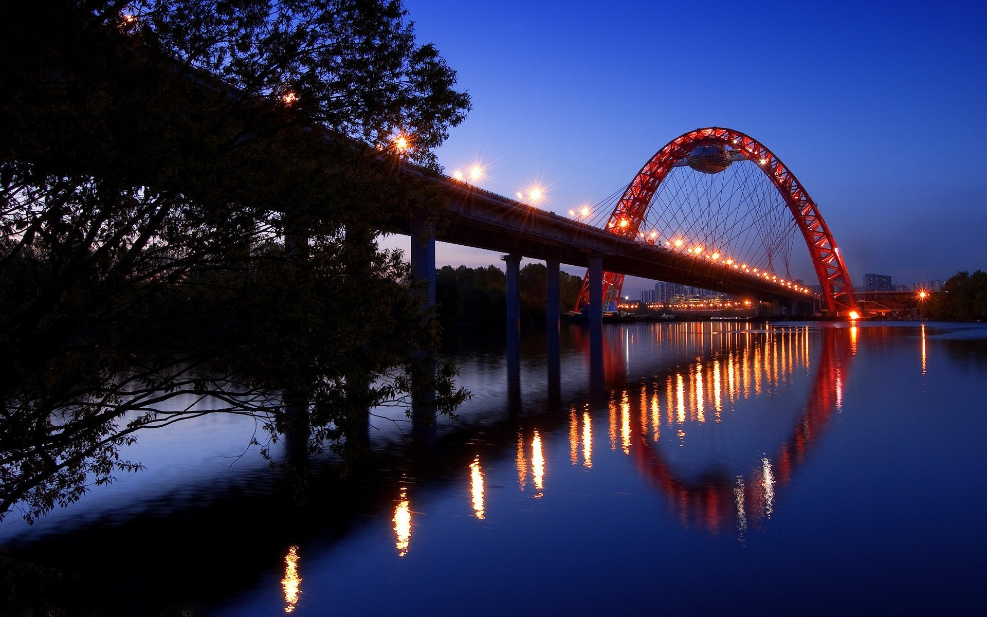 The bridge was lit with evening lights in Moscow