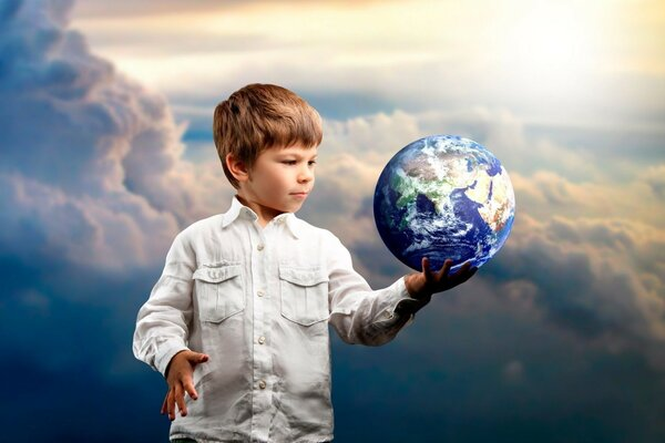 Boy holding a globe in his right hand