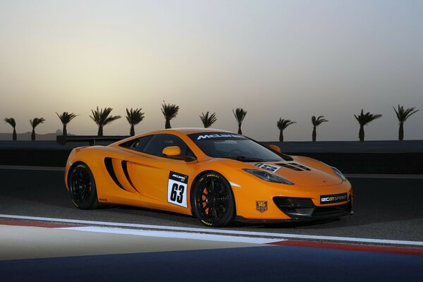 Yellow McLaren Mercedes on the race track