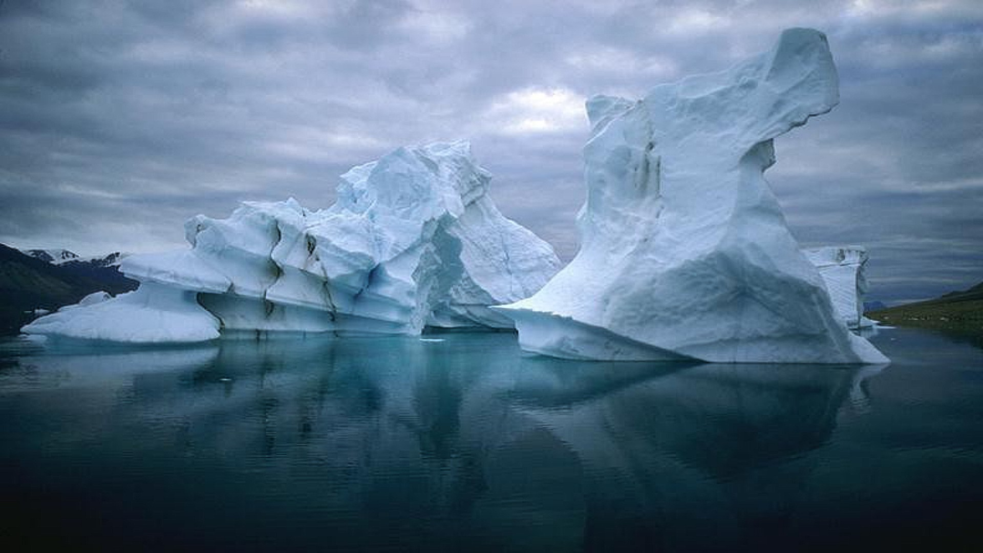 ice iceberg glacier frosty melting water snow frozen cold landscape winter swimming climate change nature reflection ocean antarctic polar travel