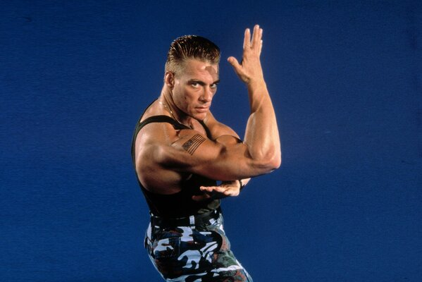 Jean-Claude van Damme demonstrates his muscles