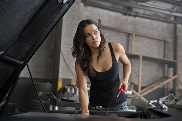 Michelle Rodriguez repairing the car in the movie fast and furious 6