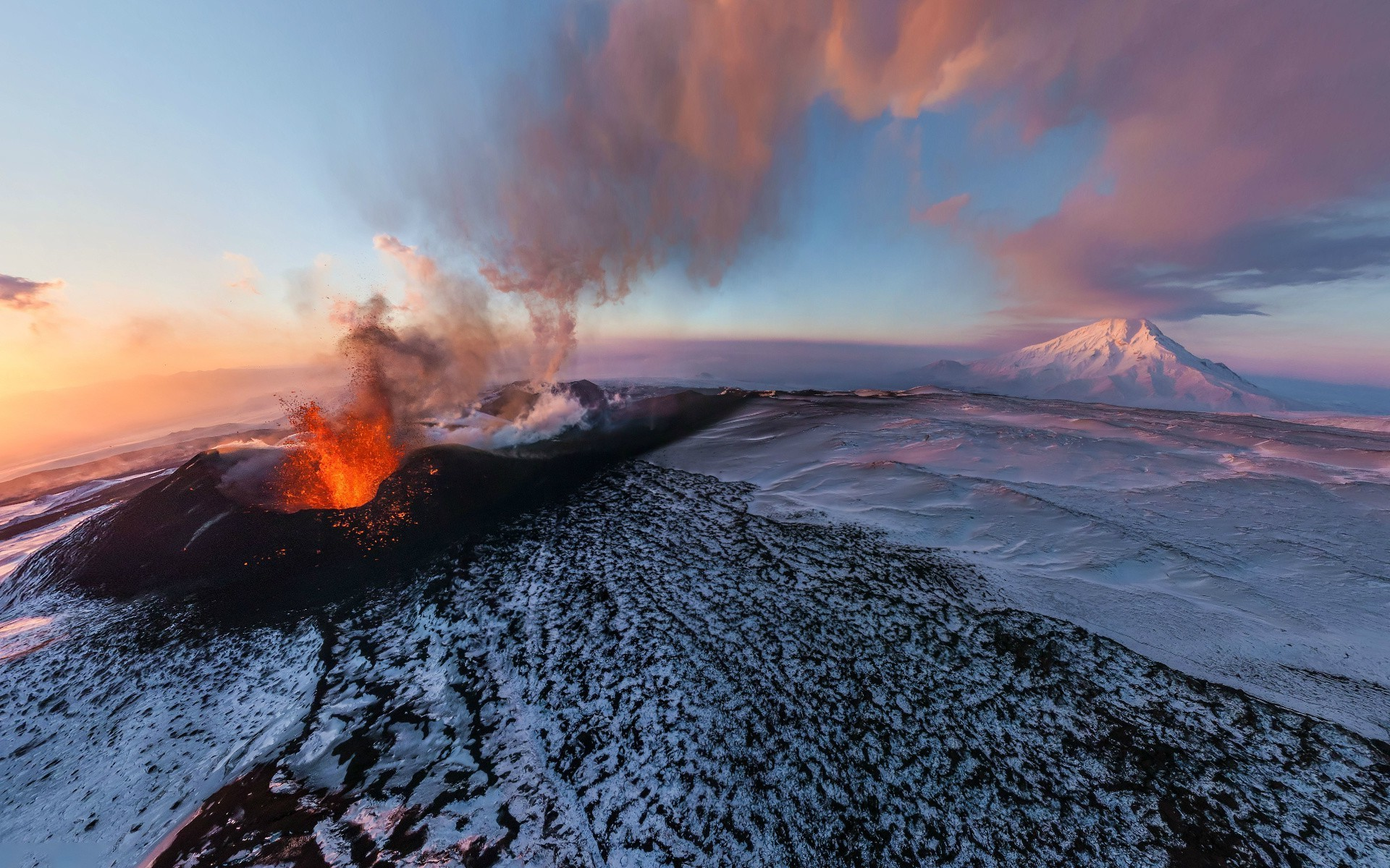 the volcano volcano sunset snow eruption landscape dawn water mountain outdoors winter evening steam smoke sky fog travel