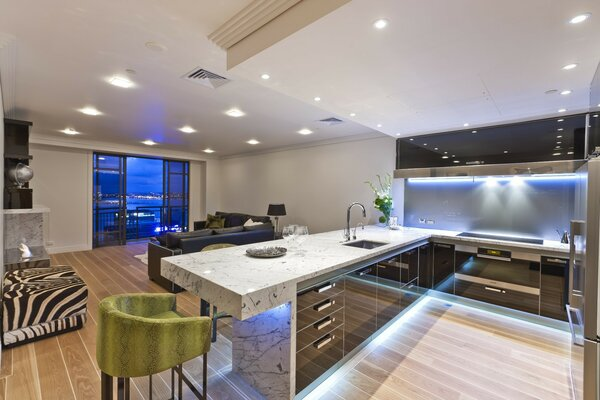 Huge kitchen with furniture made from stone slabs
