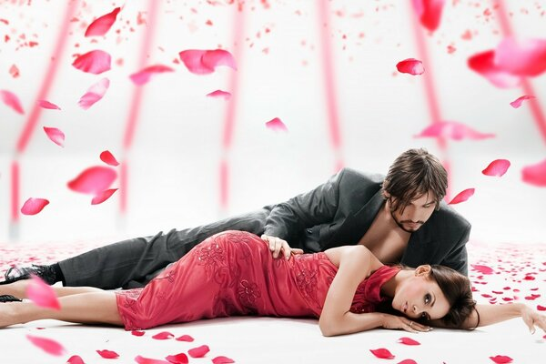 He,she and rose petals