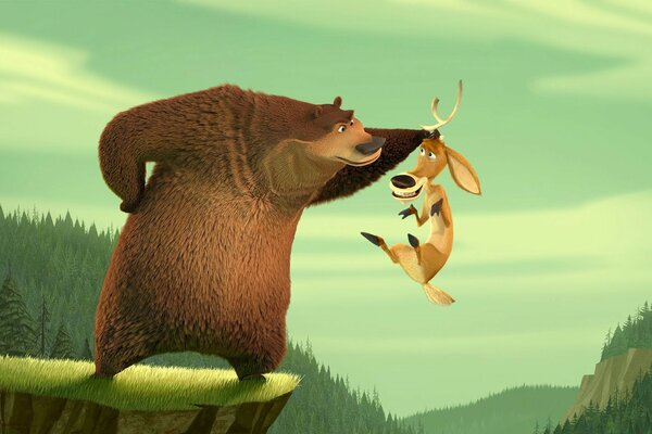 Martin Lawrence As Boog The Grizzly Bear And Ashton Kutcher As Elliot The One Horned Mule Deer In Columbia s Open Season