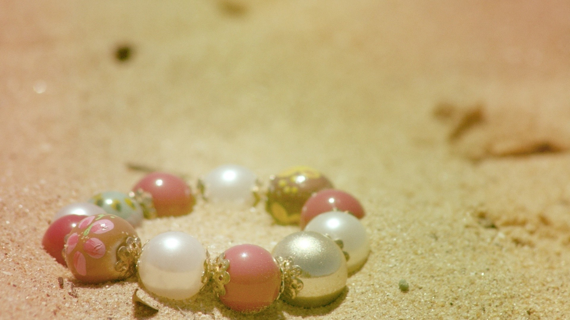 Beads in the sand