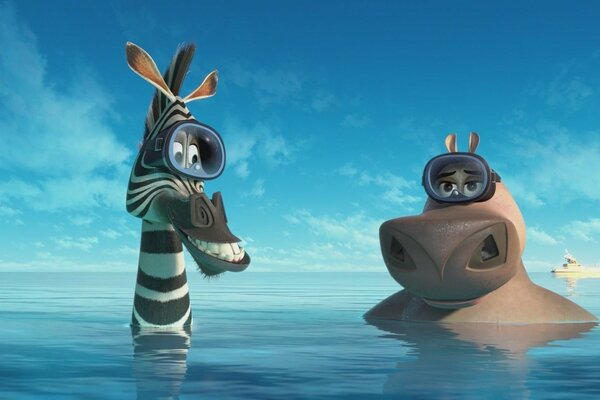 Hippo and Zebra from the cartoon Madagascar swim in the sea