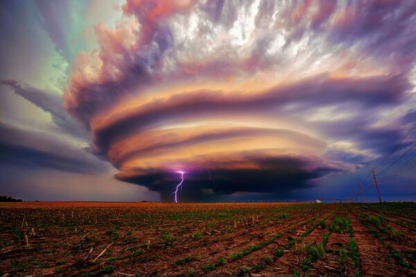 A powerful storm cloud over a field