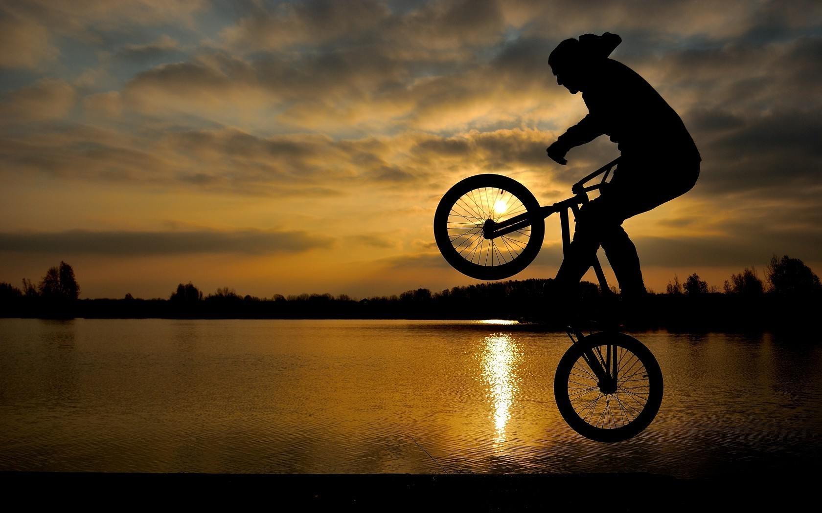 Baker performs a jump on a bmx bike android wallpapers for free voltagebd Gallery