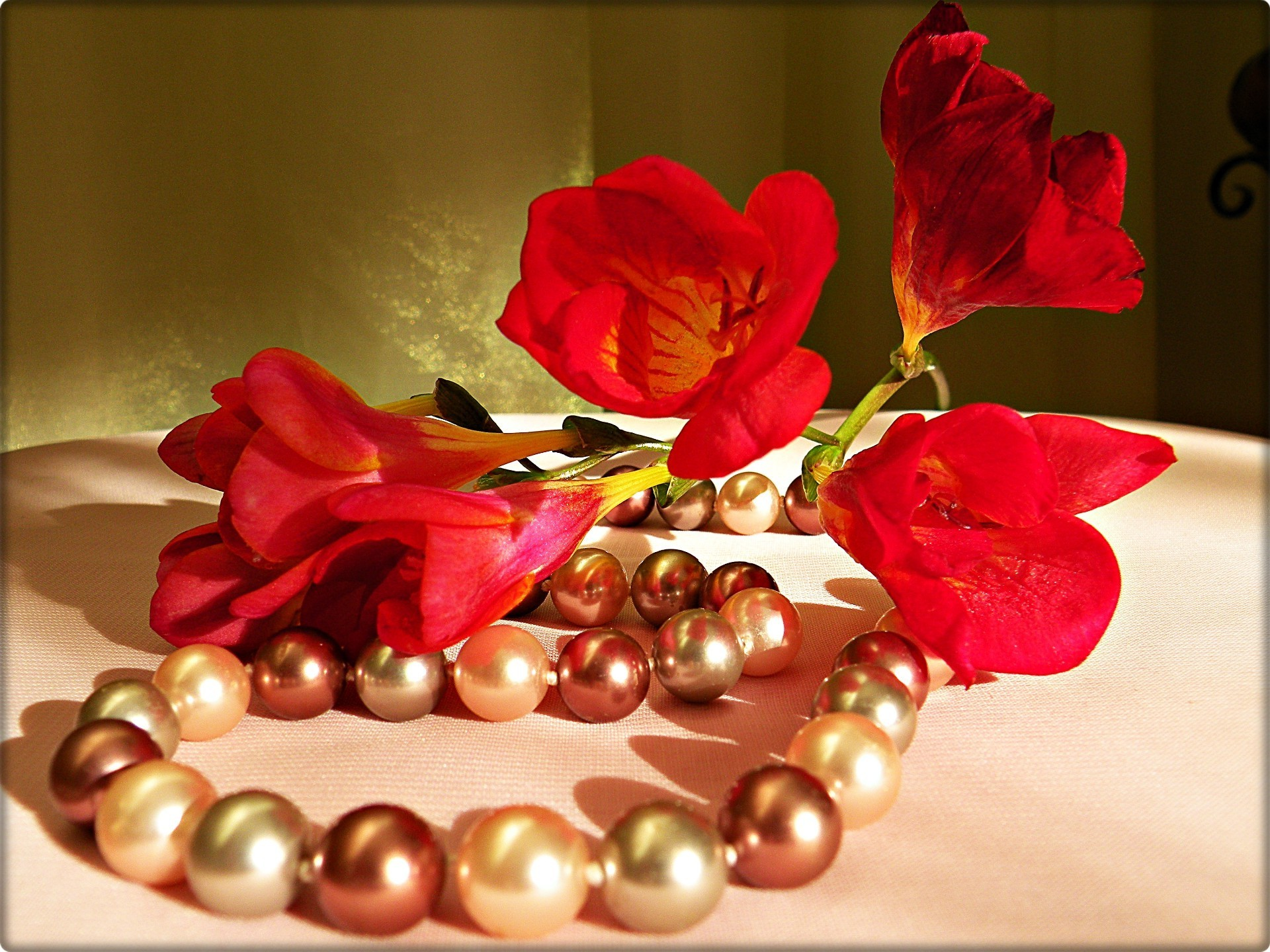 Red freesia and pearls