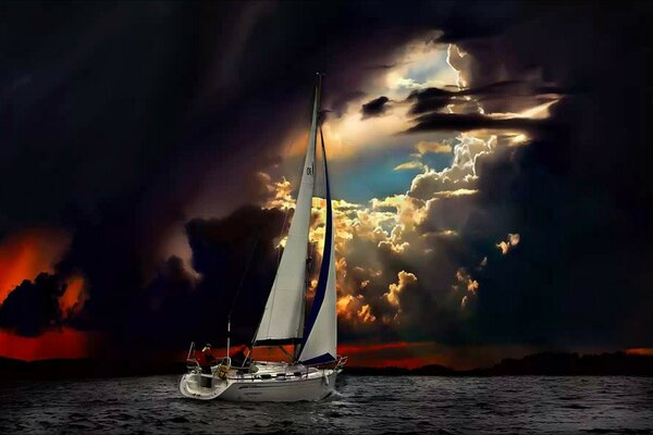 Sailing boat under stormy sky