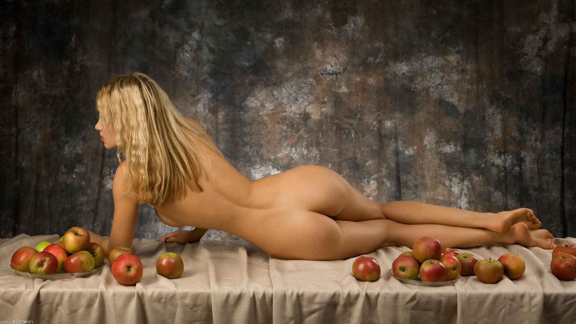 Blond girl with apples