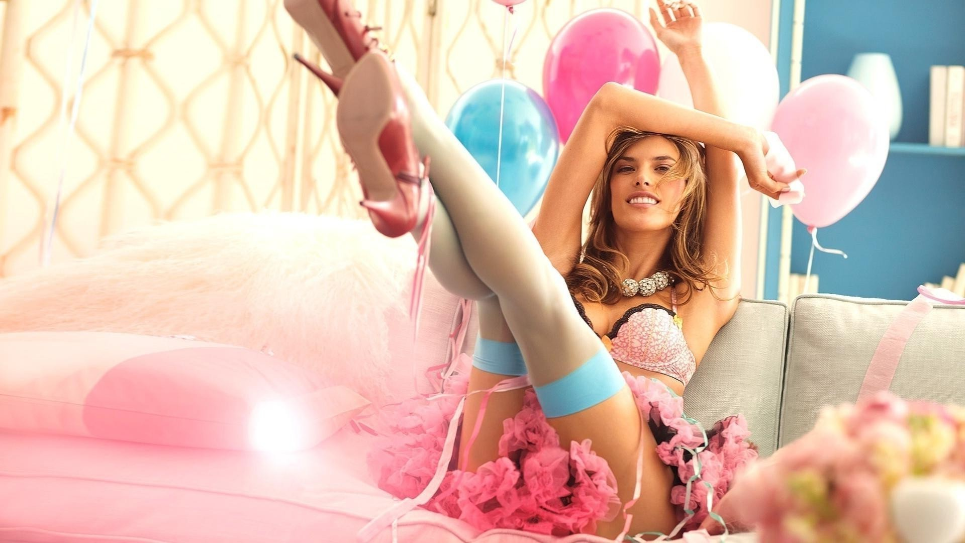 Girl with balloons on the couch