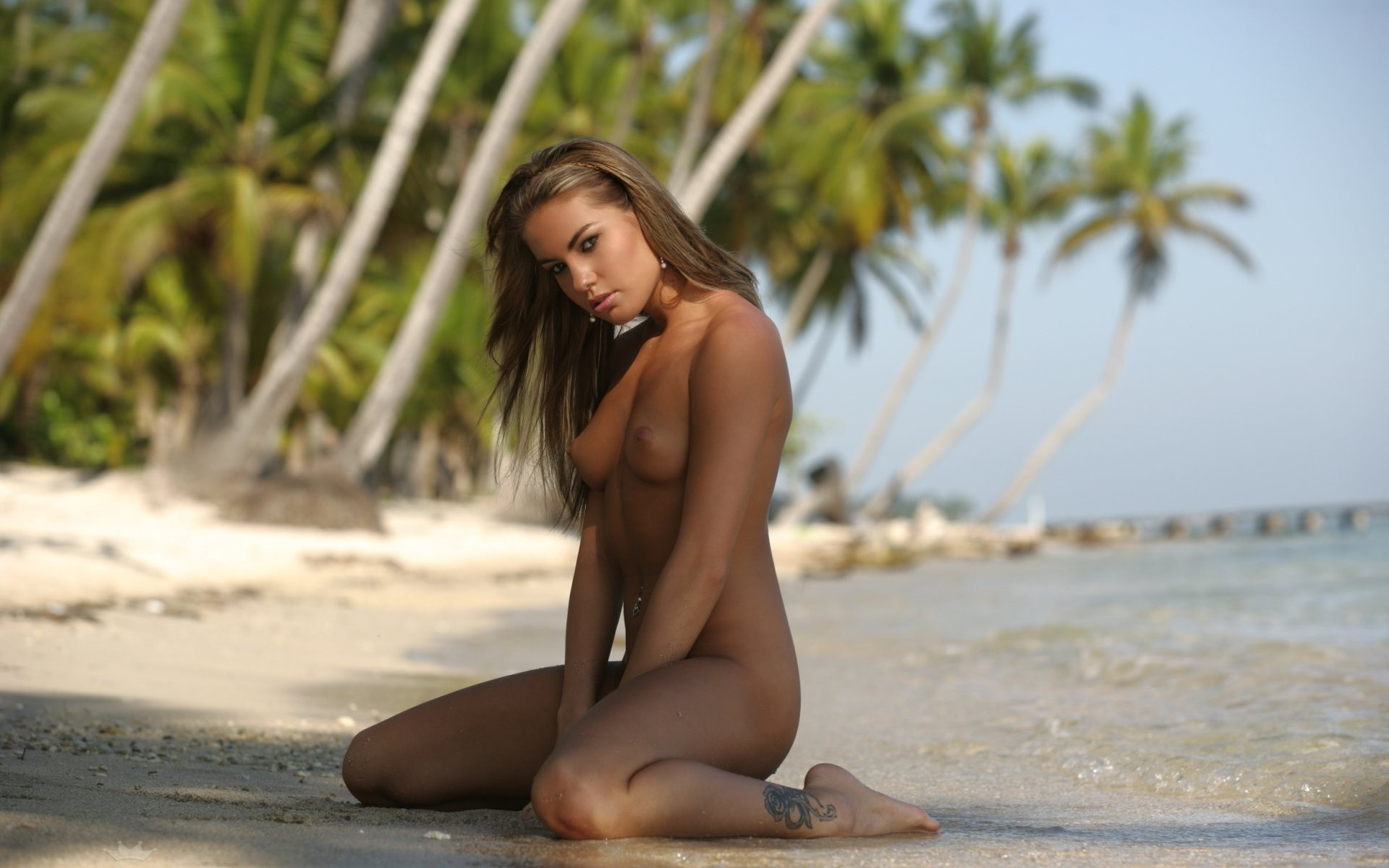 Beauty with a fatal glance is waiting Nude on the beach of the Prince