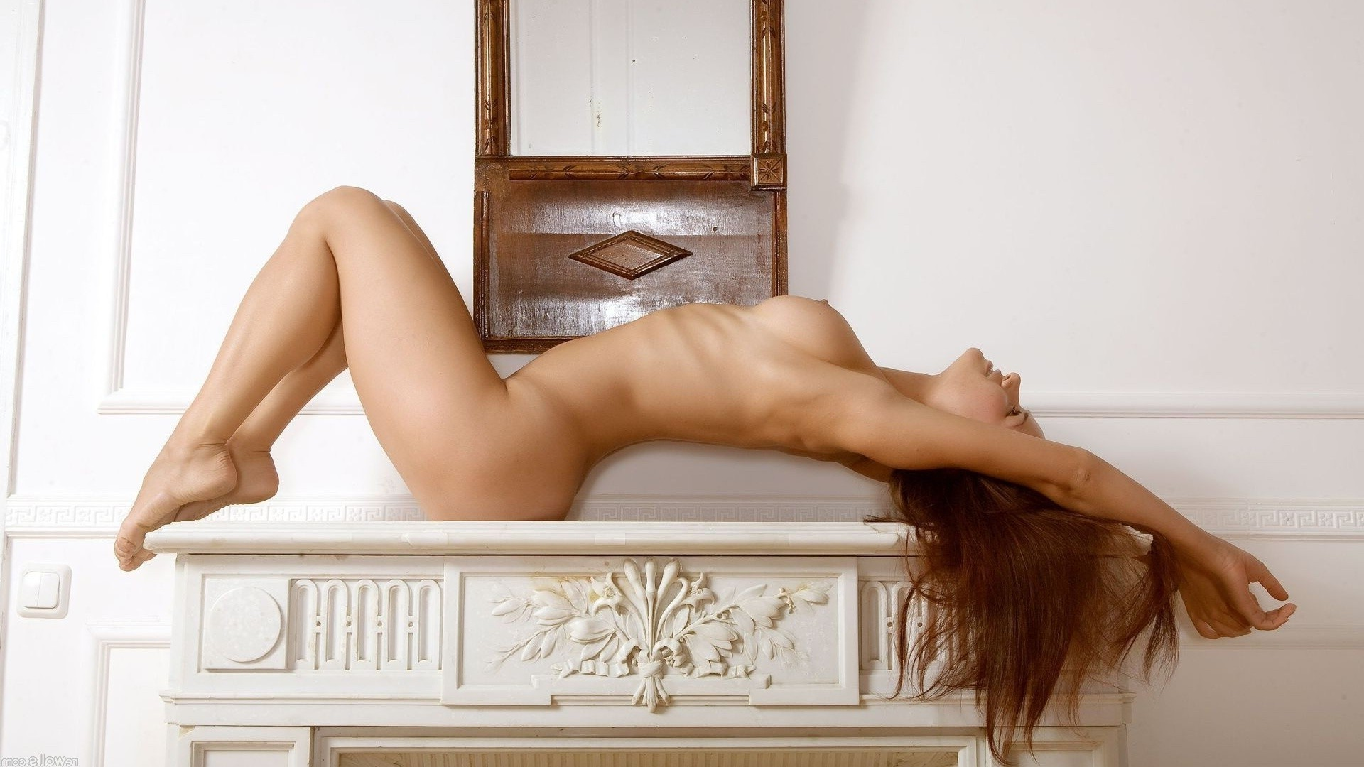Naked girl in the fireplace