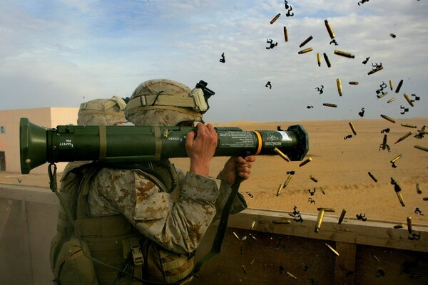 The soldier fires a Bazooka
