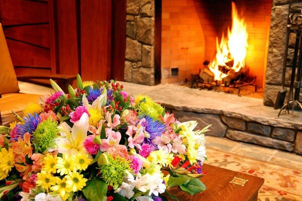 Living room with fireplace and decorated with flowers