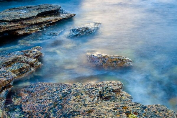 Rocks, water, fog