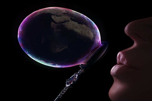 Girl inflates soap bubble