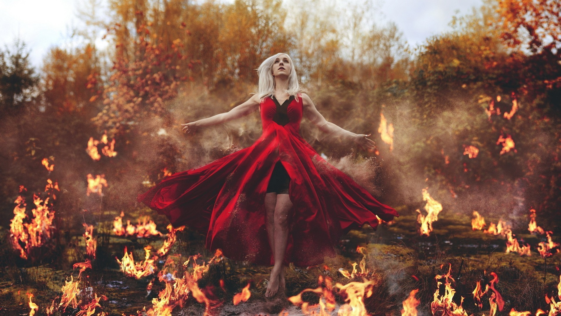 The girl in the red dress in the fire
