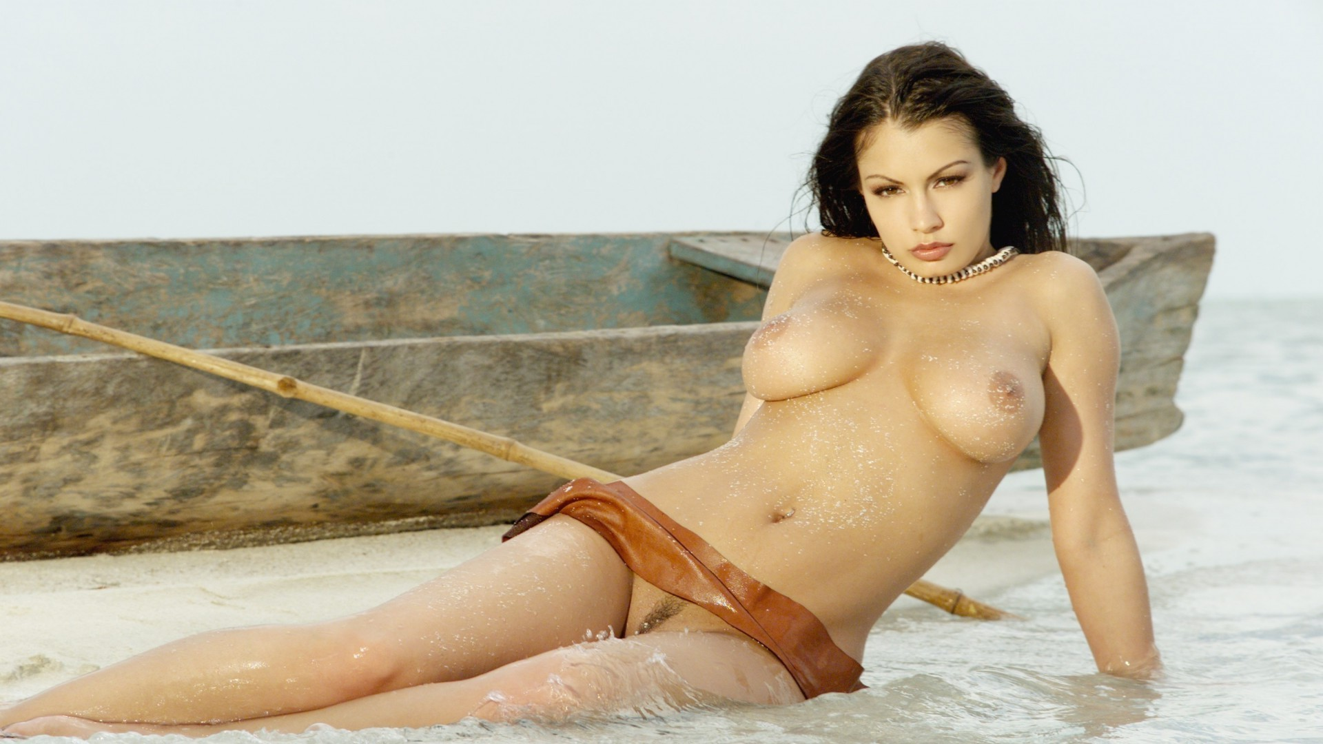 Brunette in the water near the boat