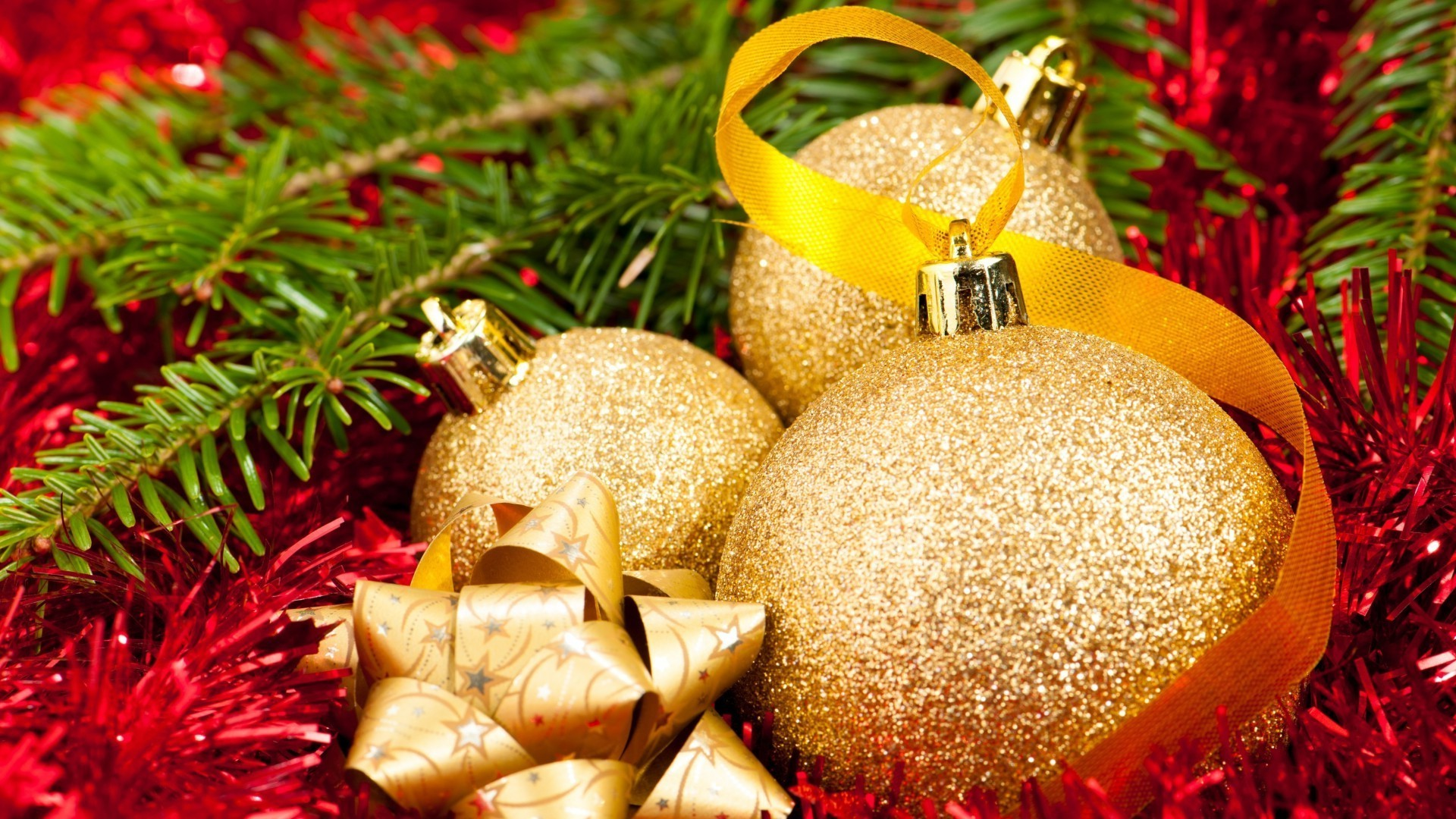 Golden balls, tinsel, fir-tree branches
