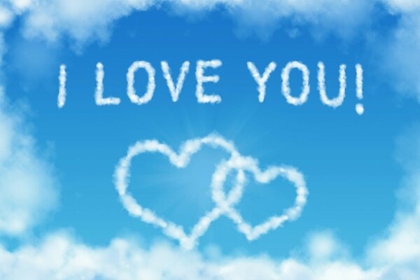 The inscription I love You in the clouds on the blue sky background