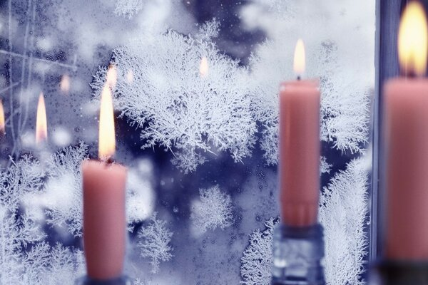 Candles at a frozen window