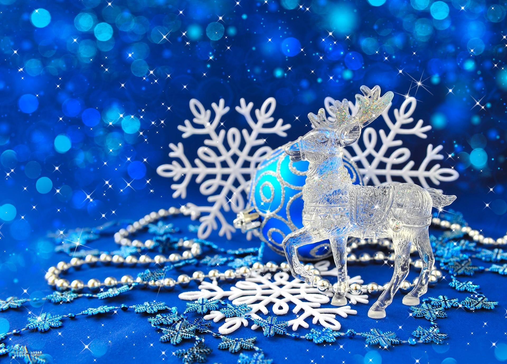 Crystal reindeer on blue Christmas background