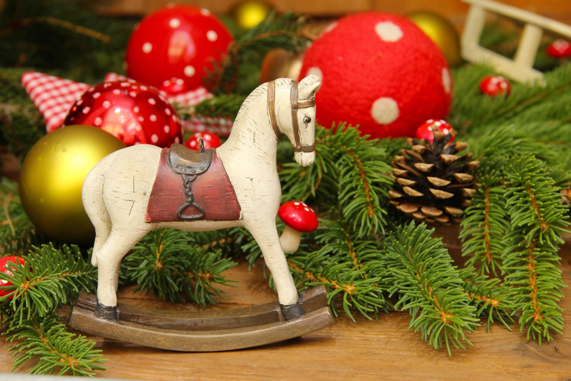 Wooden horse on the background of Christmas toys