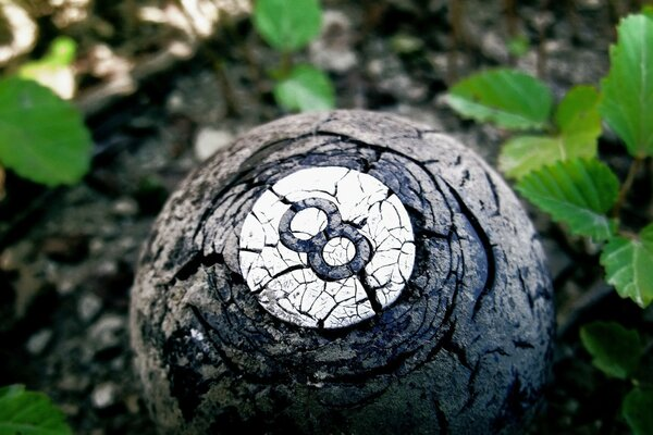 A billiard ball in the grass