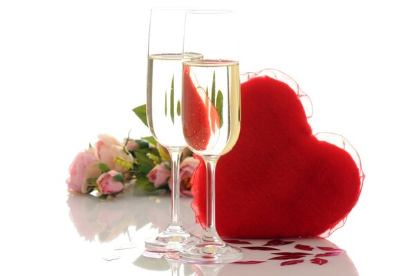 Composition with glasses of champagne, a heart and a bouquet of roses