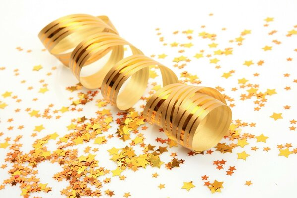 Gold spiral ribbon, scattered confetti