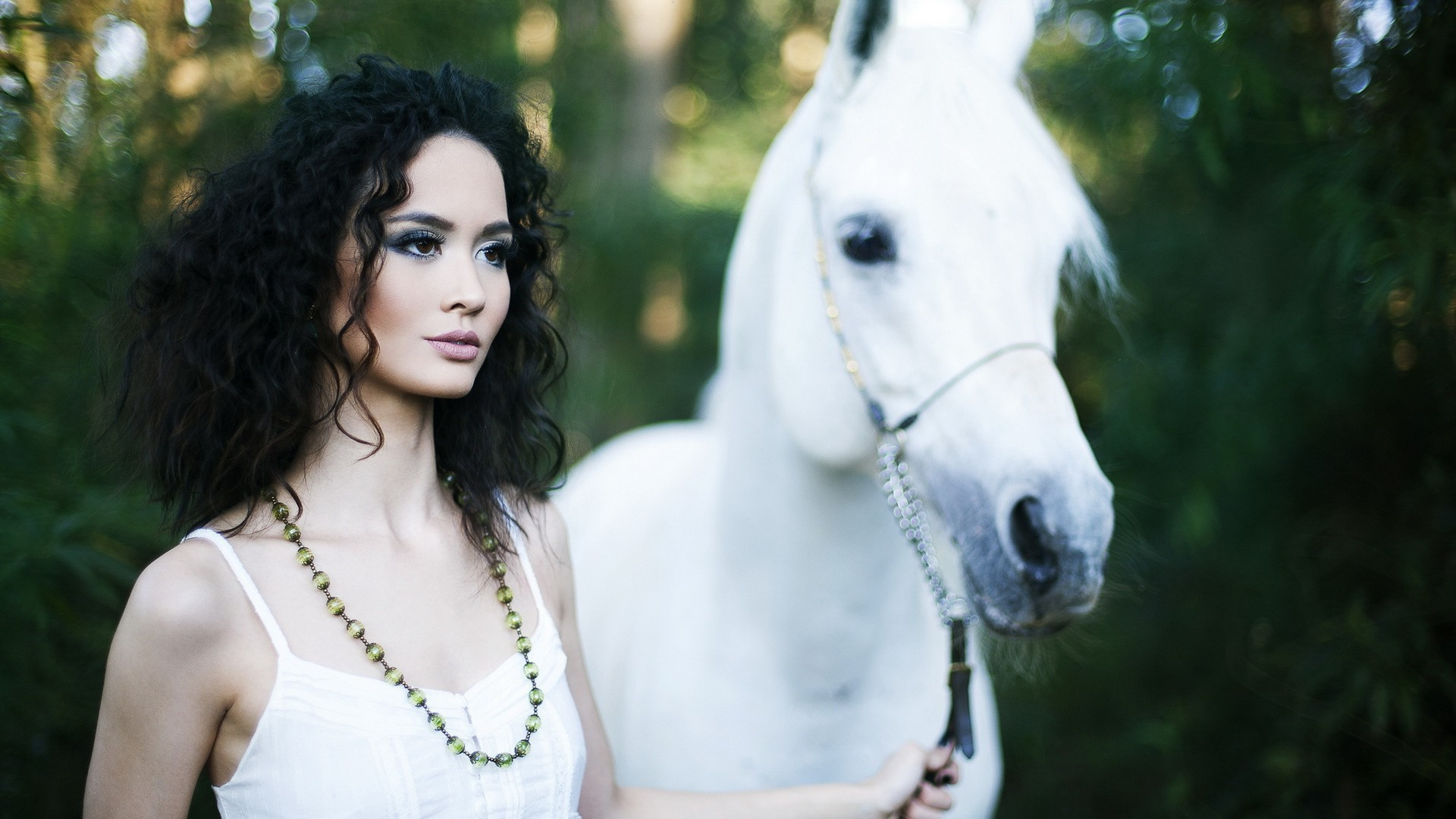 Brunette with a white stallion