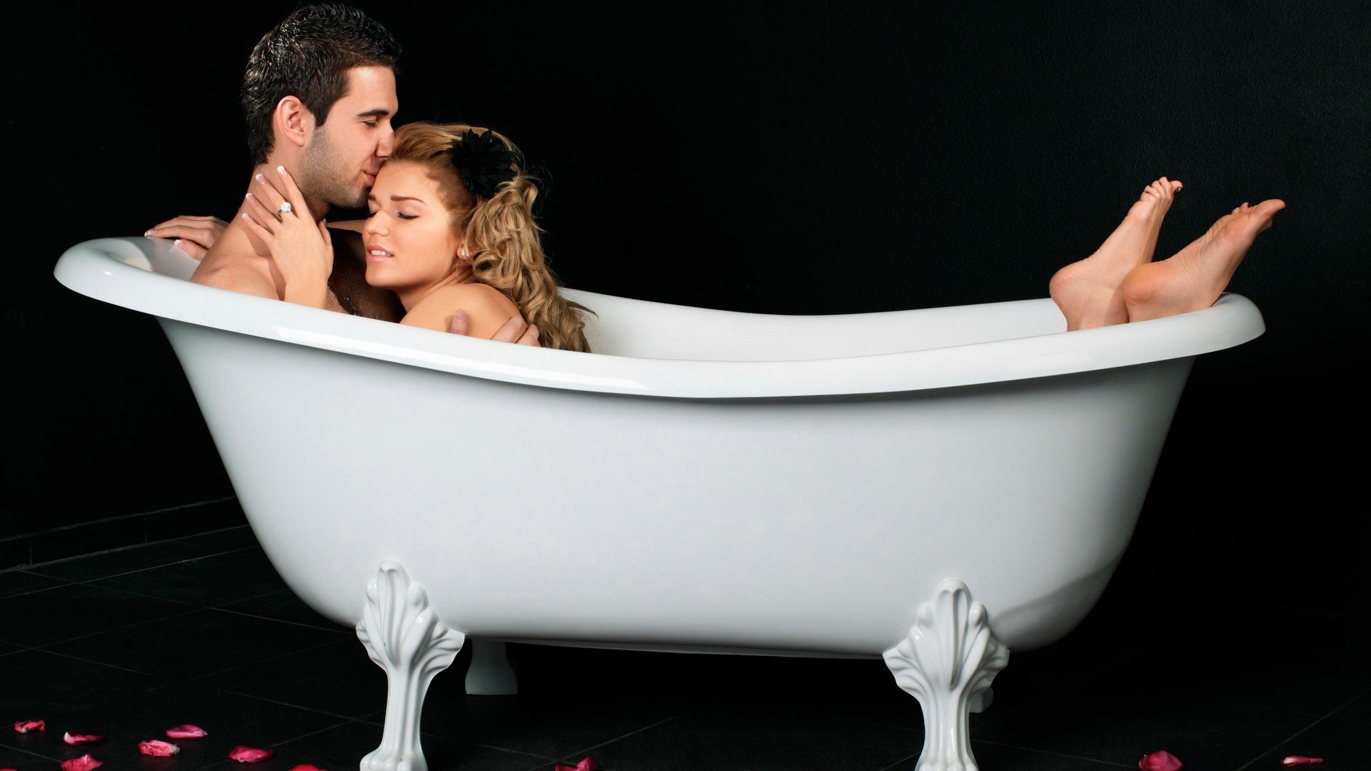 Naked couple in bathtub