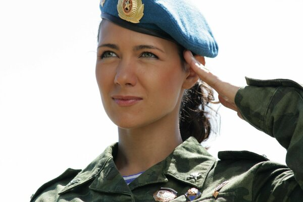 Russian girl in military uniform saluting