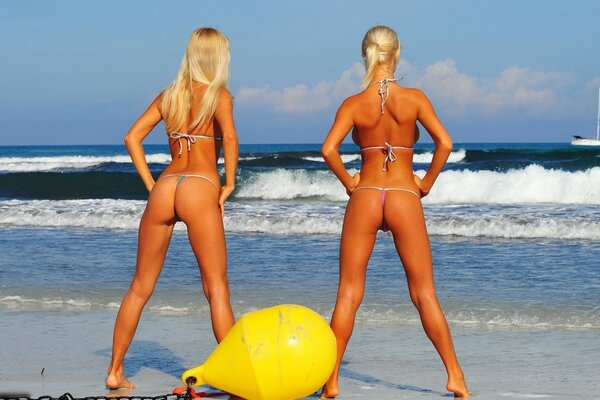 Two blondes in bikinis with firm Asses watching yacht