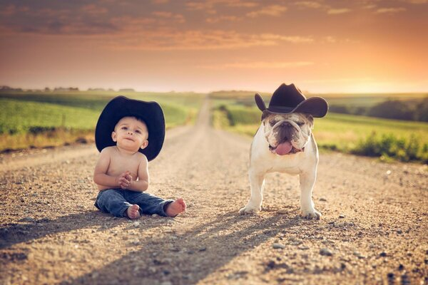 Young cowboy and his faithful dog in hats