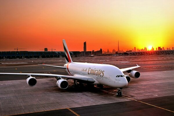 The plane of Emirates airline on the runway and