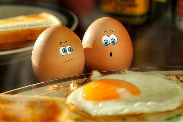 Two eggs considering the corpse of a fellow murdered people and fried