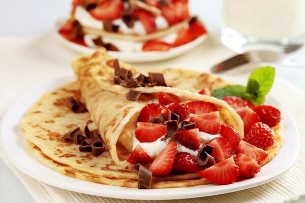 Pancakes with strawberries and chocolate