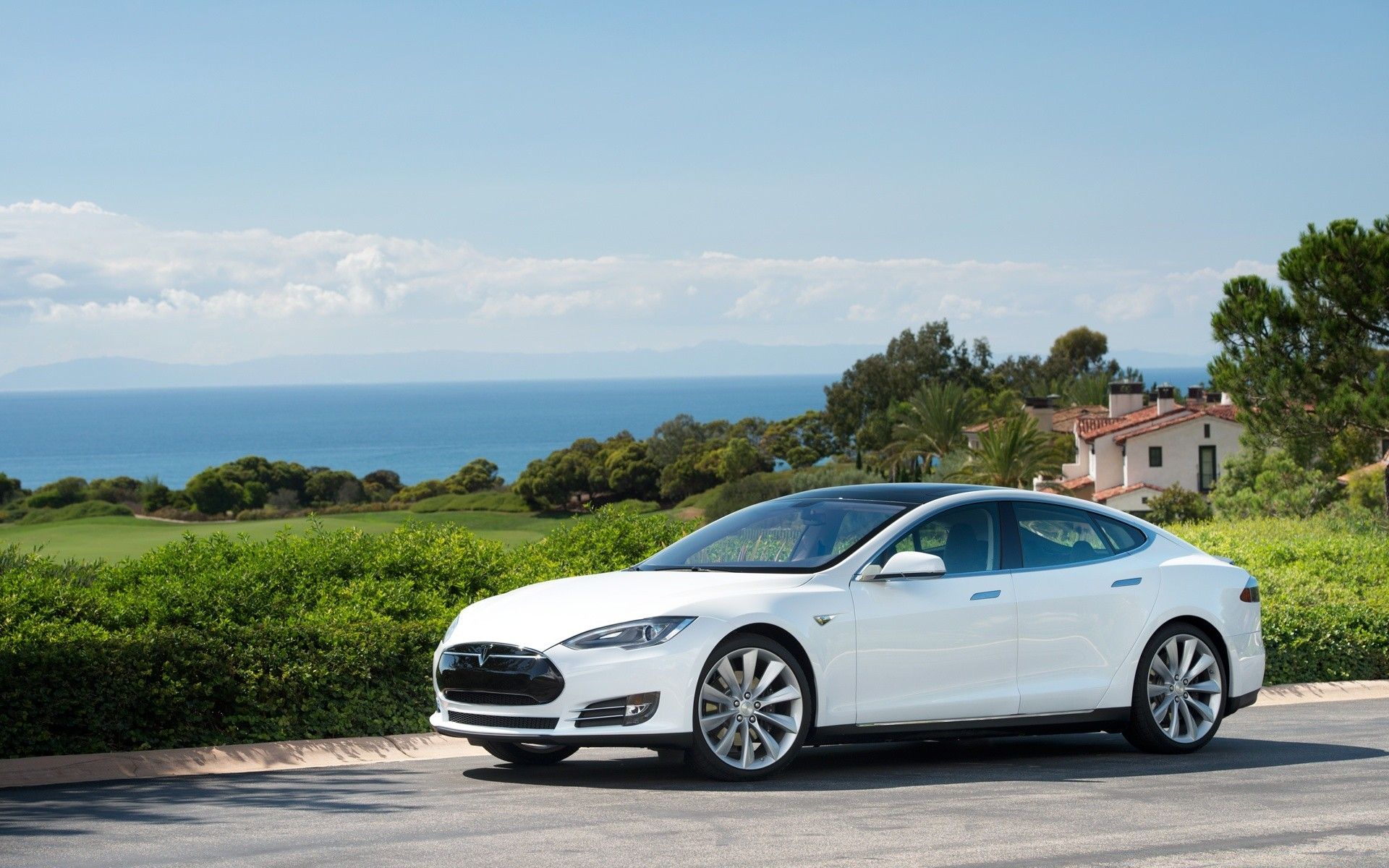Tesla Model S In White Ocean View Android Wallpapers