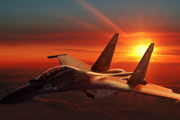 Fighter aircraft at sunset