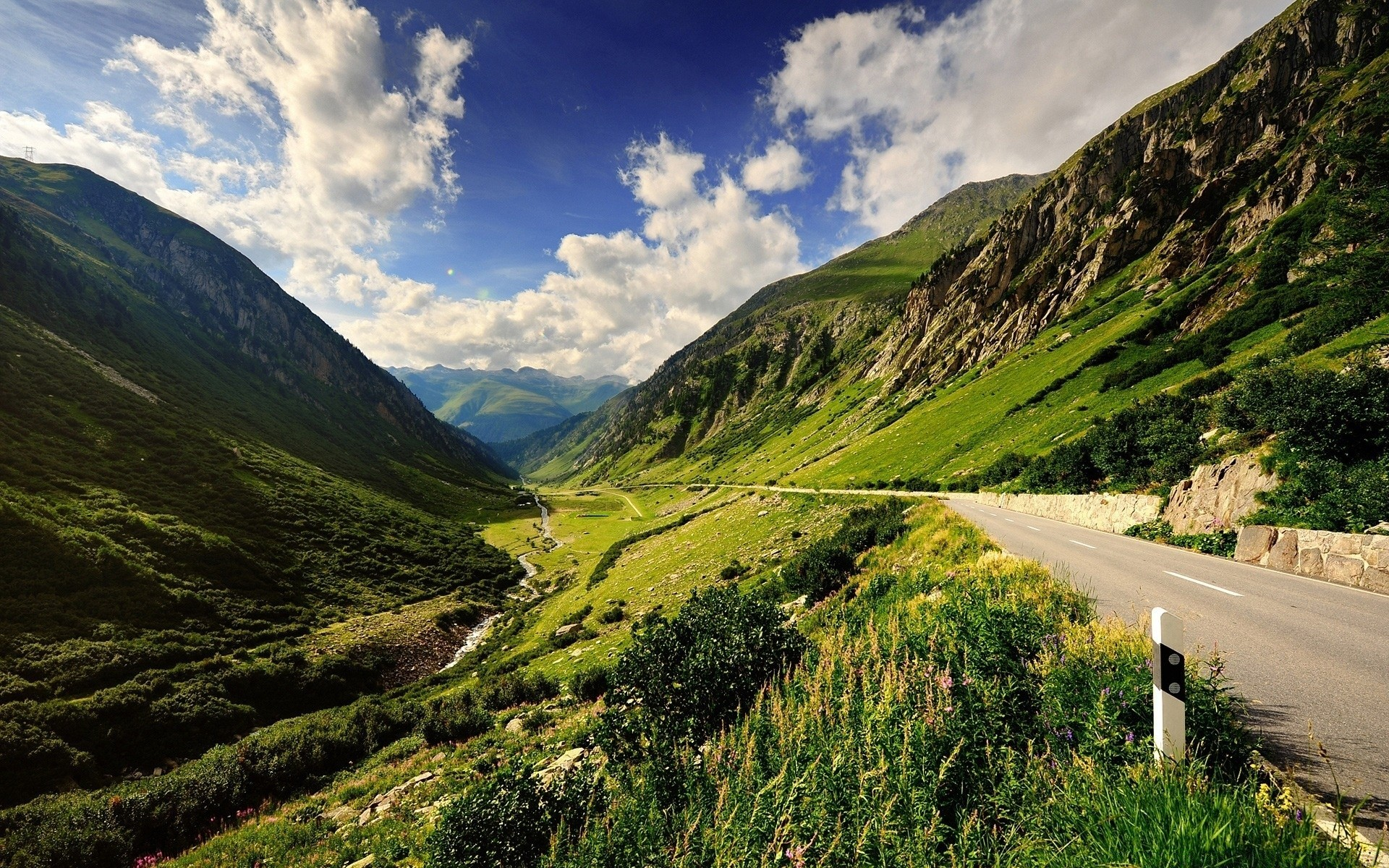 mountains travel nature mountain outdoors landscape sky grass summer road valley hill scenic countryside water