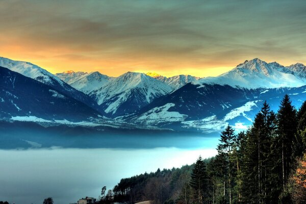 Snowy Mountains And Fog Filled Valley
